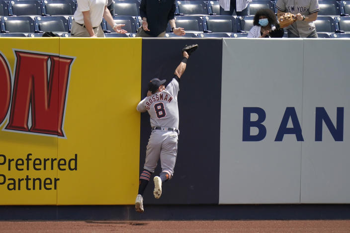 Detroit Tigers right fielder Robbie Grossman grabs a sacrifice fly hit by New York Yankees' Brett Gardner during the second inning of a baseball game at Yankee Stadium, Sunday, May 2, 2021, in New York. (AP Photo/Seth Wenig)