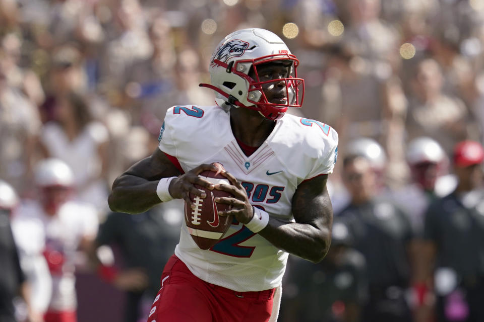 New Mexico quarterback Terry Wilson (2) looks to pass against Texas A&M during the first quarter of an NCAA college football game on Saturday, Sept. 18, 2021, in College Station, Texas. (AP Photo/Sam Craft)