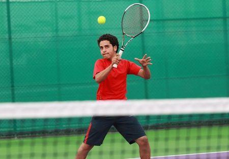 Alhassan Ishaq from Sanaa, 13, takes part in a training session at Khalifa International Tennis and Squash Complex in Doha