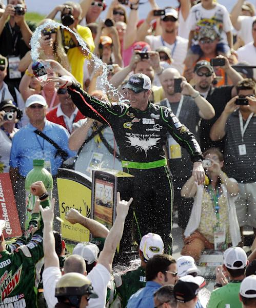 Dale Earnhardt Jr. celebrates in victory lane after winning the NASCAR Sprint Cup Series Quicken Loans 400 auto race at Michigan International Speedway, Sunday, June 17, 2012, in Brooklyn, Mich. (AP Photo/Carlos Osorio)
