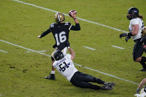 Purdue quarterback Aidan O'Connell (16) tries to throw as he's tackled by Northwestern linebacker Blake Gallagher (51) during the fourth quarter of an NCAA college football game in West Lafayette, Ind., Saturday, Nov. 14, 2020. Northwestern defeated Purdue 27-20. (AP Photo/Michael Conroy)