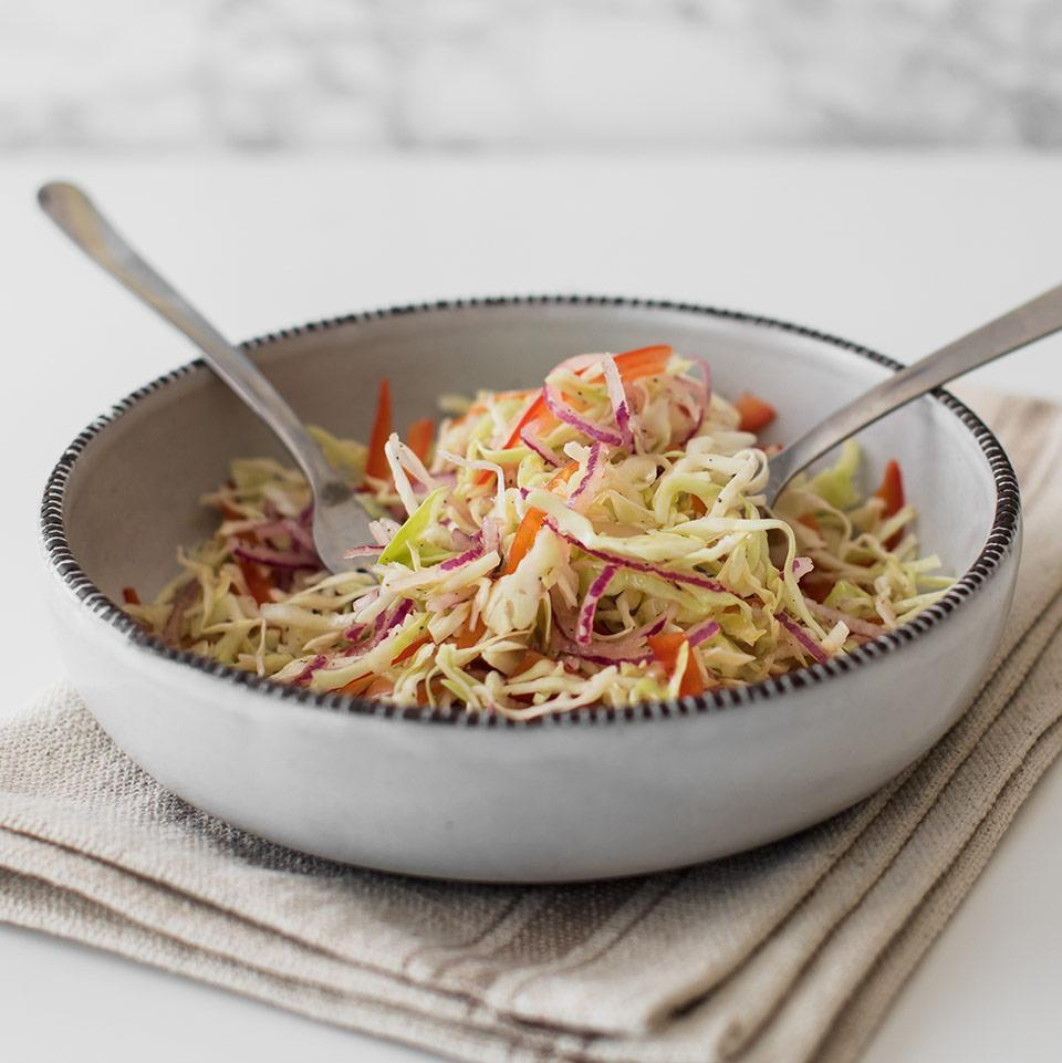 <p>Although it's not a traditional topping for American tacos, cabbage slaw is an essential ingredient when making fish tacos. This colorful, vinegar-dressed coleslaw can be made in just a few minutes. Use preshredded cabbage to make it even quicker.</p>