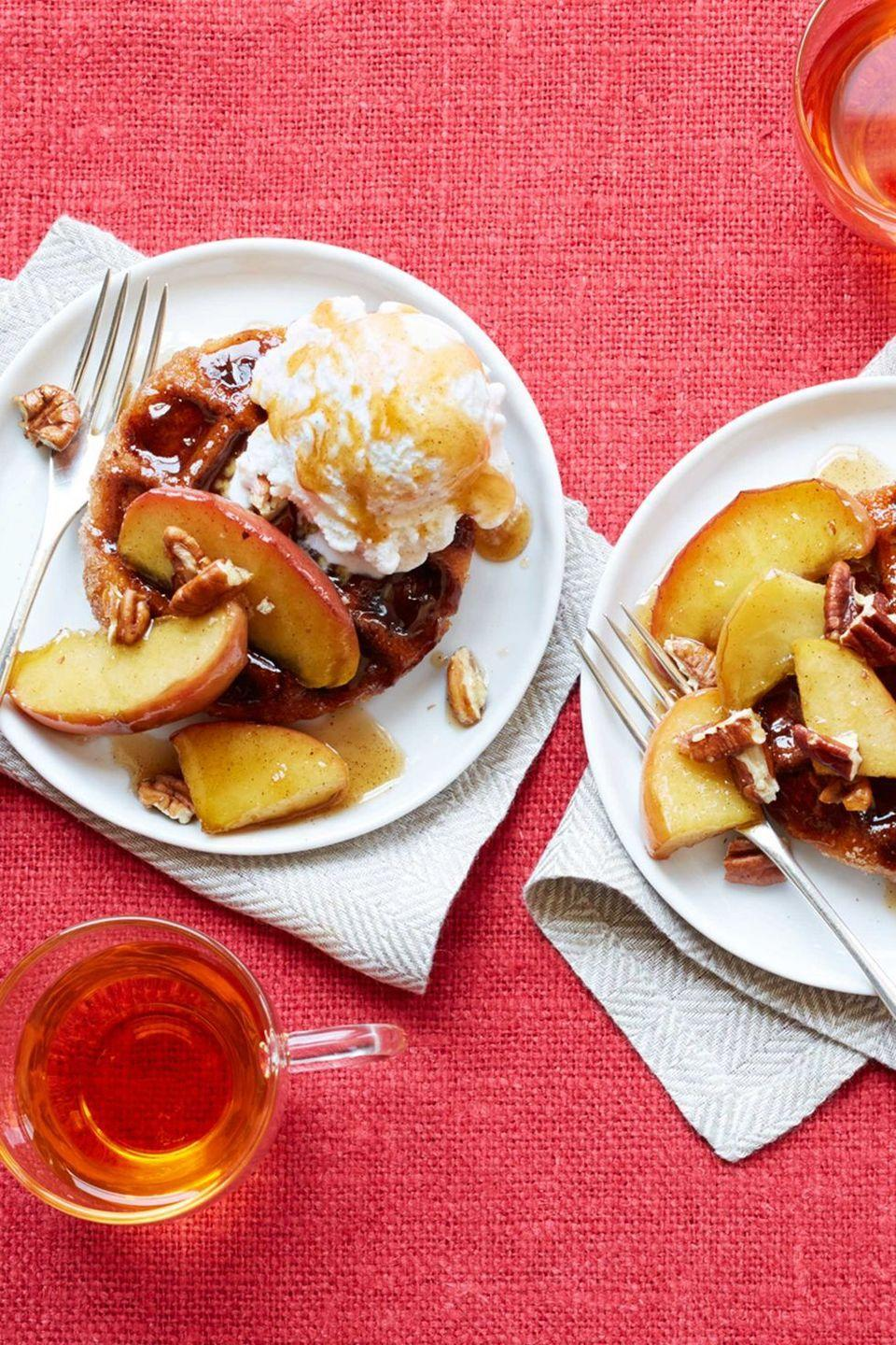 "<p>These waffles are so deliciously sweet, you'll want to have them as a dessert, not for breakfast! The sautéed apples give them the perfect fall taste. </p><p><strong><em><a href=""https://www.womansday.com/food-recipes/food-drinks/recipes/a56158/sugared-waffles-with-sauteed-recipe/"" rel=""nofollow noopener"" target=""_blank"" data-ylk=""slk:Get the Sugared Waffles with Sautéed Maple Apples recipe."" class=""link rapid-noclick-resp"">Get the Sugared Waffles with Sautéed Maple Apples recipe. </a></em></strong></p>"