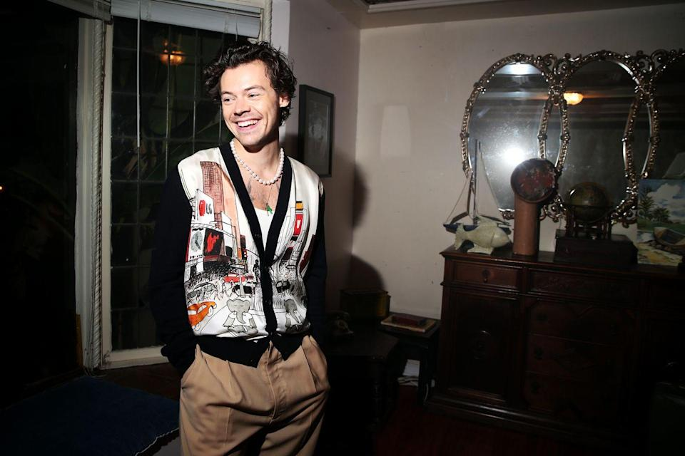 <p>Normally, Harry Styles floats above trends. But in the big barrel of statement knitwear, the 'Golden' boy is knee-deep in a printed Lanvin cardigan and muted slacks. </p>