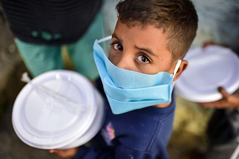 A child from the Favela Aglomerado da Serra in Brazil. It's feared the slum-like conditions will be overwhelmed with the virus. Source: Getty