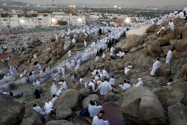 <p>Muslim pilgrims gather on Mount Mercy on the plains of Arafat during the annual haj pilgrimage, outside the holy city of Mecca, Saudi Arabia , Aug. 31, 2017. (Photo: Suhaib Salem/Reuters) </p>