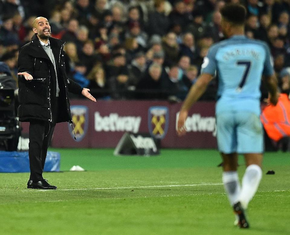Manchester City's Spanish manager Pep Guardiola (L) shouts instructions to midfielder Raheem Sterling from the touchline during their game against West Ham United in London on February 1, 2017 (AFP Photo/Glyn KIRK )