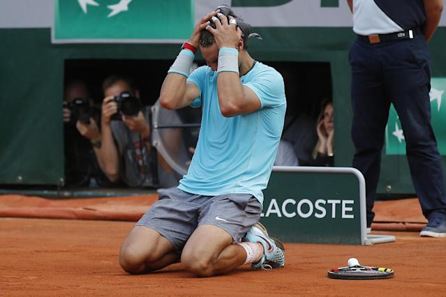 Spain's Rafael Nadal celebrates winning the final of the French Open tennis tournament against Serbia's Novak Djokovic at the Roland Garros stadium, in Paris, France, Sunday, June 8, 2014. Nadal won in four sets 3-6, 7-5, 6-2, 6-4. (AP Photo/Michel Euler)