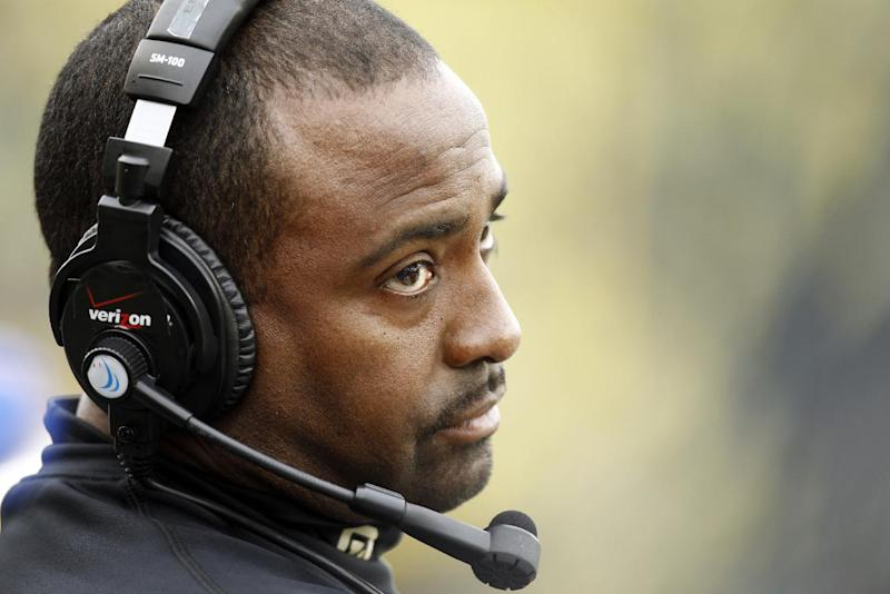 Colorado coach Jon Embree looks at the scoreboard after an Oregon touchdown during the first half of an NCAA college football game in Eugene, Ore., Saturday, Oct. 27, 2012. (AP Photo/Don Ryan)