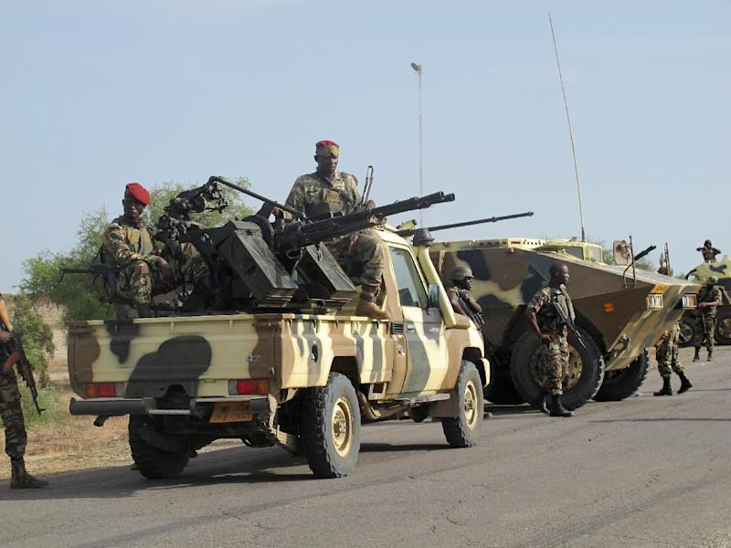 A convoy of Cameroon's soldiers, part of a reinforcement of its military forces against Nigerian Islamist group Boko Haram, is seen on June 17, 2014 in Dabanga, northern Cameroon