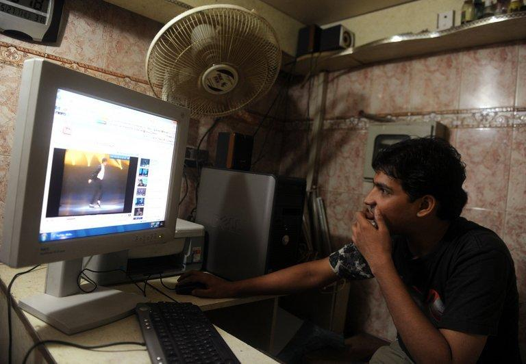 A man looks at YouTube at an internet cafe in Karachi, on May 27, 2010