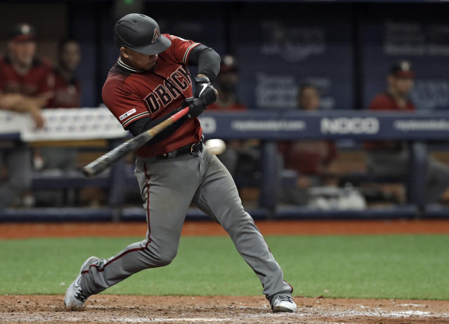 Arizona Diamondbacks' Eduardo Escobar hits a single off Tampa Bay Rays relief pitcher Adam Kolarek during the 13th inning of a baseball game Wednesday, May 8, 2019, in St. Petersburg, Fla. The Diamondbacks won 3-2. (AP Photo/Chris O'Meara)