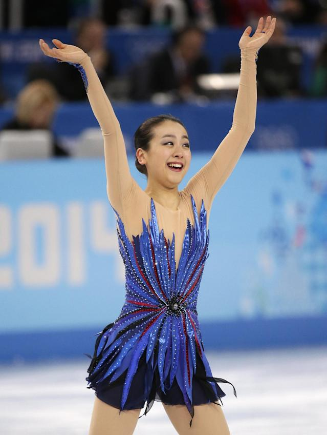 Mao Asada of Japan acknowledges the crowd after completing her routine in the women's free skate figure skating finals at the Iceberg Skating Palace during the 2014 Winter Olympics, Thursday, Feb. 20, 2014, in Sochi, Russia. (AP Photo/Bernat Armangue)