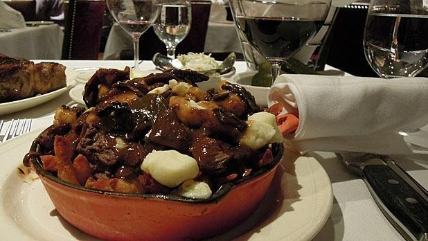 """<p>Montreal's <a href=""""http://moishes.ca/"""" rel=""""nofollow noopener"""" target=""""_blank"""" data-ylk=""""slk:Moishe's Steakhouse"""" class=""""link rapid-noclick-resp"""">Moishe's Steakhouse</a> has been in business for over 75 years. Their dinner menu abounds with steaks, from a Filet Mignon appetizer to a selection of cuts, along with a separate menu dedicated entirely to dry-aged beef, Moishe's sticks close to its Romanian roots. But dishes like the steak poutine prove this is the quintessential Canadian steakhouse. </p><p><i>(Photo Courtesy of slgckgc / Flickr)</i></p><p><b><a href=""""http://www.mensjournal.com/food-drink/recipes/the-secret-to-making-the-perfect-steak-indoors-20150313?utm_source=yahoofood&utm_medium=referral&utm_campaign=steakhousesworld"""" rel=""""nofollow noopener"""" target=""""_blank"""" data-ylk=""""slk:Related: The Secret to Making the Perfect Steak Indoors"""" class=""""link rapid-noclick-resp"""">Related: <i>The Secret to Making the Perfect Steak Indoors</i></a></b></p>"""