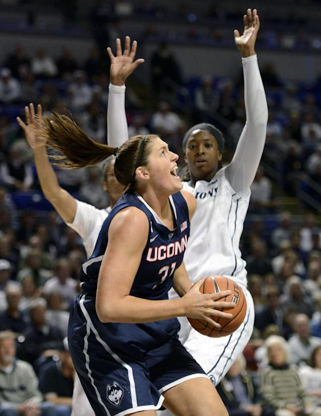 Connecticut's Stefanie Dolson (31) drives to the basket past Penn State's Candice Agee (1) during the first half of an NCAA college basketball game, Sunday, Nov. 17, 2013, in State College, Pa. (AP Photo/John Beale)