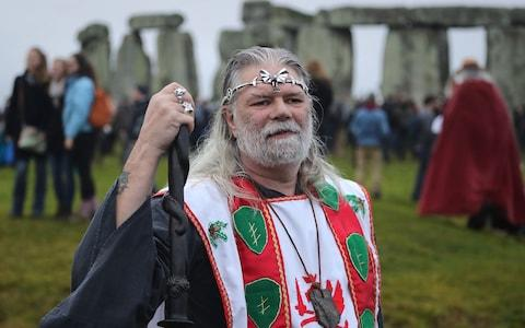 Arthur Pendragon poses as Druids, pagans and revellers gather in the centre of Stonehenge, hoping to see the sun rise, as they take part in a winter solstice ceremony - Credit: Matt Cardy/Getty Images
