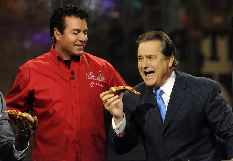 """Papa John's Founder, Chairman and CEO John Schnatter, delivers a pizza to the NFL Network set at the NFL Media Center, promoting Papa John's Super Bowl XLVII Coin Toss Experience, Thursday, Jan. 31, 2013, in New Orleans.  Consumers can call """"heads"""" or """"tails"""" for the game's coin toss through 11:59 p.m. PST Saturday at www.papajohns.com or the brand's Facebook page, and if they are correct, they will win a free large Papa John's pizza.  Papa John's is giving fans 50 percent off their next pizza offer just for voting.(Photo by Jack Dempsey/Invision for Papa John's/AP Images)"""