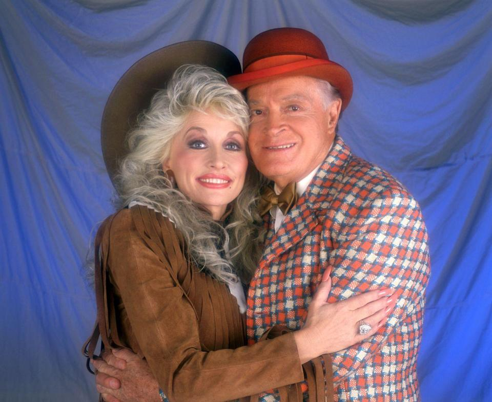<p>Leaning in for a hug here, Dolly actually made an appearance on Bob Hope's 1988 Christmas special, where she played a reindeer in a skit alongside Bob.</p>