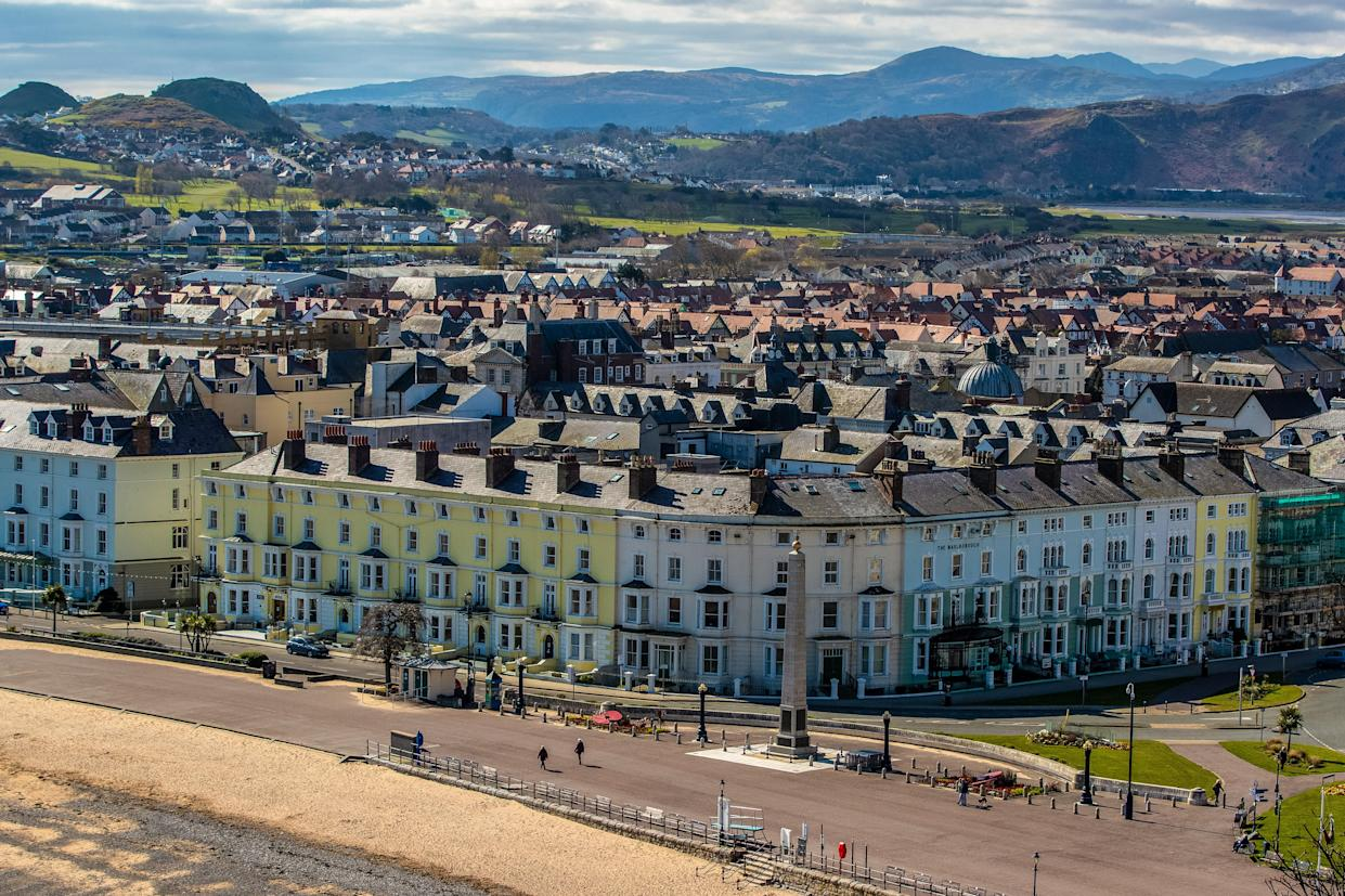 The seafront at Llandudno, north Wales, with dramatic landscape in the background (Getty Images)