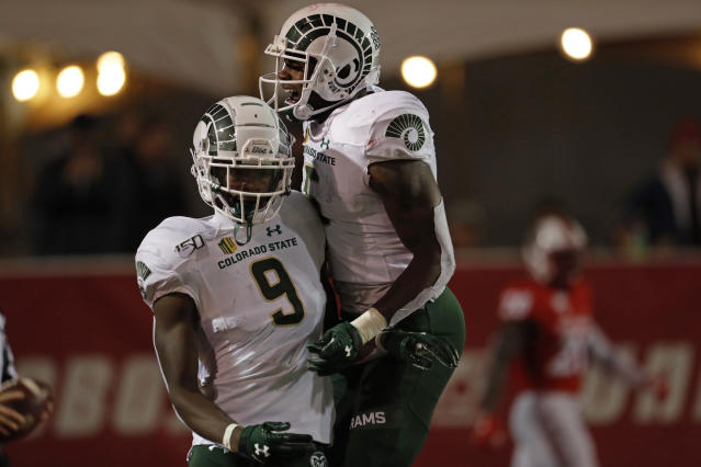 Colorado State wide receiver Warren Jackson (9) is congratulated by Marvin Kinsey (5) after scoring a touchdown during the first half of an NCAA college football game against New Mexico on Friday, Oct. 11, 2019 in Albuquerque, N.M. (AP Photo/Andres Leighton)