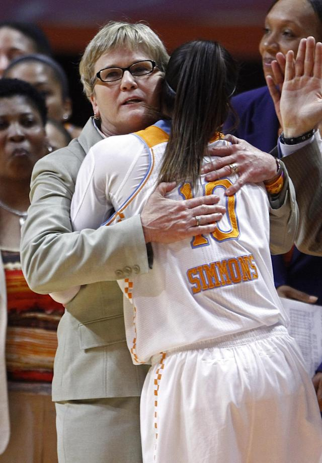 Tennessee guard Meighan Simmons (10) gets a hug from head coach Holly Warlick while coming out of an NCAA college basketball game in the second half against South Carolina, Sunday, March 2, 2014, in Knoxville, Tenn. Tennessee won 73-61. (AP Photo/Wade Payne)