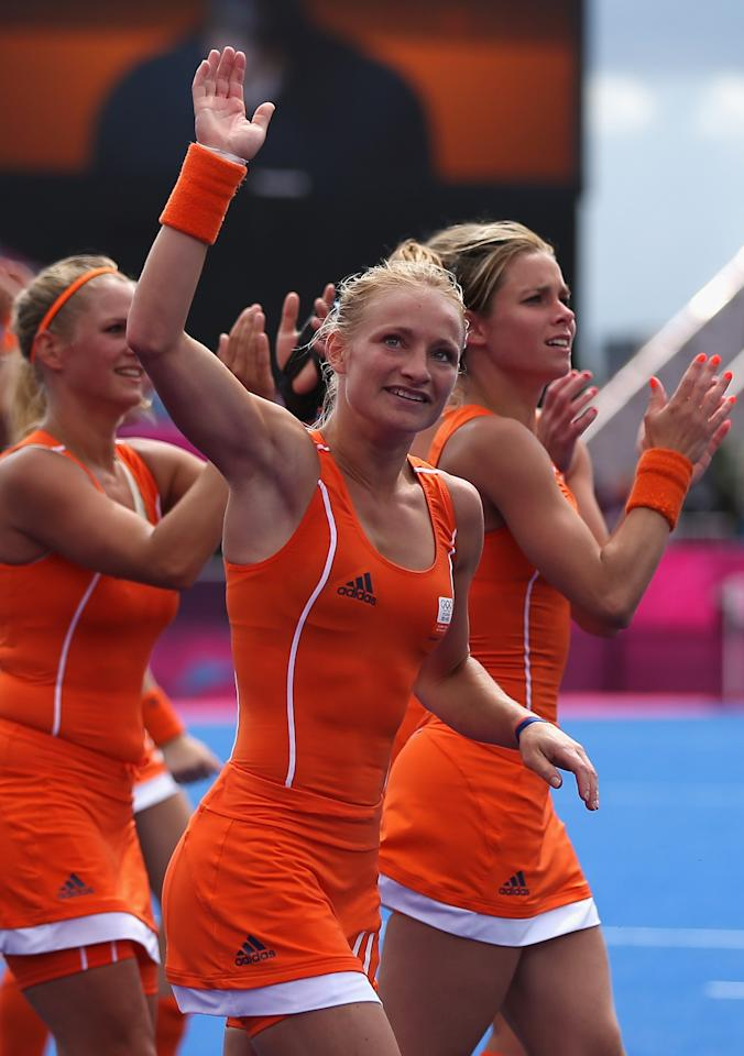 LONDON, ENGLAND - JULY 29:  Maartje Goderie of Netherlands and herteam mates celebrate victory at the end of the Women's Pool WA Match W02 between the Netherlands and Belgium at the Hockey Centre on July 29, 2012 in London, England.  (Photo by Daniel Berehulak/Getty Images)