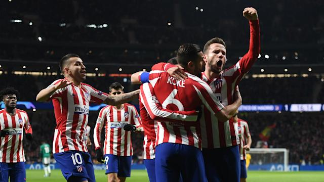 Atletico Madrid beat Lokomotiv Moscow 2-0 in Wednesday's Champions League Group D clash to make certain of a place in the knockout stage.