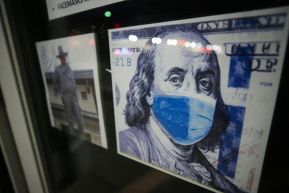 The Ben Franklin store displays an image of Franklin wearing a face mask on Oct. 29 in Winterset, Iowa. (Mario Tama/Getty Images)