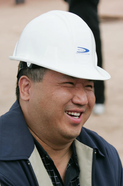 FILE- In this file photo taken March 7, 2007, David Jin, an investor for the Skywalk project, is all smiles at the rollout for the Skywalk on the Hualapai Indian Reservation in Grand Canyon West, Ariz. A federal court has upheld a $28 million judgment against a business arm of the northern Arizona tribe that owns the Grand Canyon Skywalk. The American Arbitration Association had awarded Las Vegas businessman David Jin the money in August. His attorneys went to federal court to enforce it. Jin invested $30 million to build the Skywalk, a glass bridge that gives visitors a view of the Colorado River from the Hualapai reservation. (AP Photo/Ross D. Franklin, File)