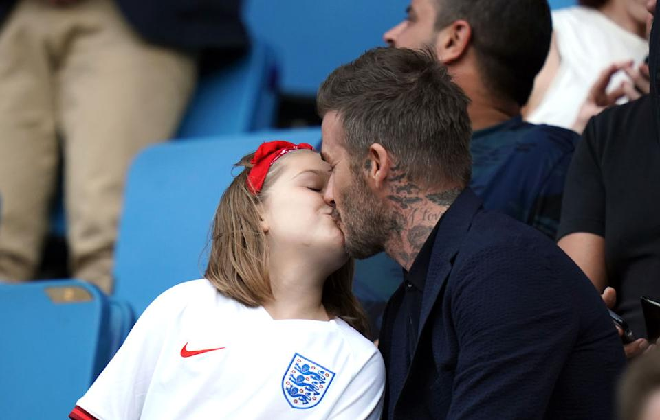 David Beckham isn't going to let trolls or Piers Morgan stop him kissing daughter Harper on the lips [Photo: Getty]