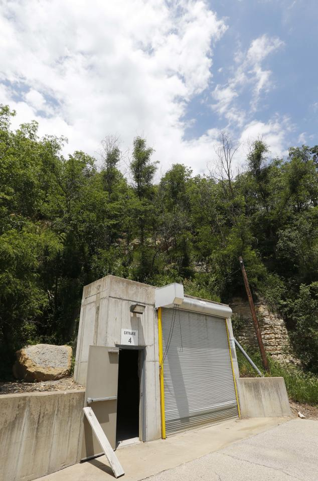 A door stands open at an entrance to the Vivos Shelter and Resort during a tour of the facility in Atchison, Kan., Tuesday, June 18, 2013. (AP Photo/Orlin Wagner)