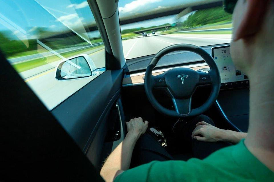 Tesla instructs drivers to keep their hands on the wheel when its Autopilot feature is engaged. The feature has been implicated in multiple accidents, drawing scrutiny in Washington. (Dreamstime/TNS)