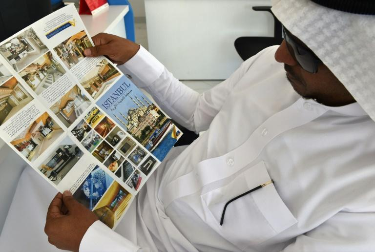 A Saudi customer reads a tourist leaflet about Turkey at a travel agency in Riyadh, amid fears a downturn in visitors could hurt the fragile Turkish economy (AFP Photo/FAYEZ NURELDINE)