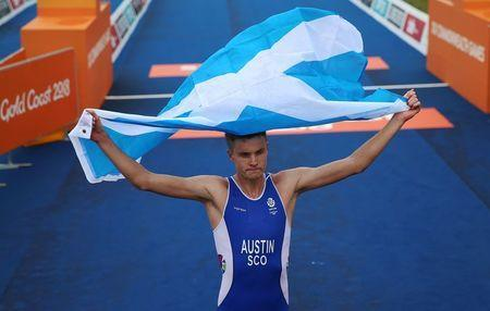 Triathlon - Gold Coast 2018 Commonwealth Games - Men's Final - Southport Broadwater Parklands - Gold Coast, Australia - April 5, 2018 - Marc Austin of Scotland after finishing in third place. REUTERS/Athit Perawongmetha
