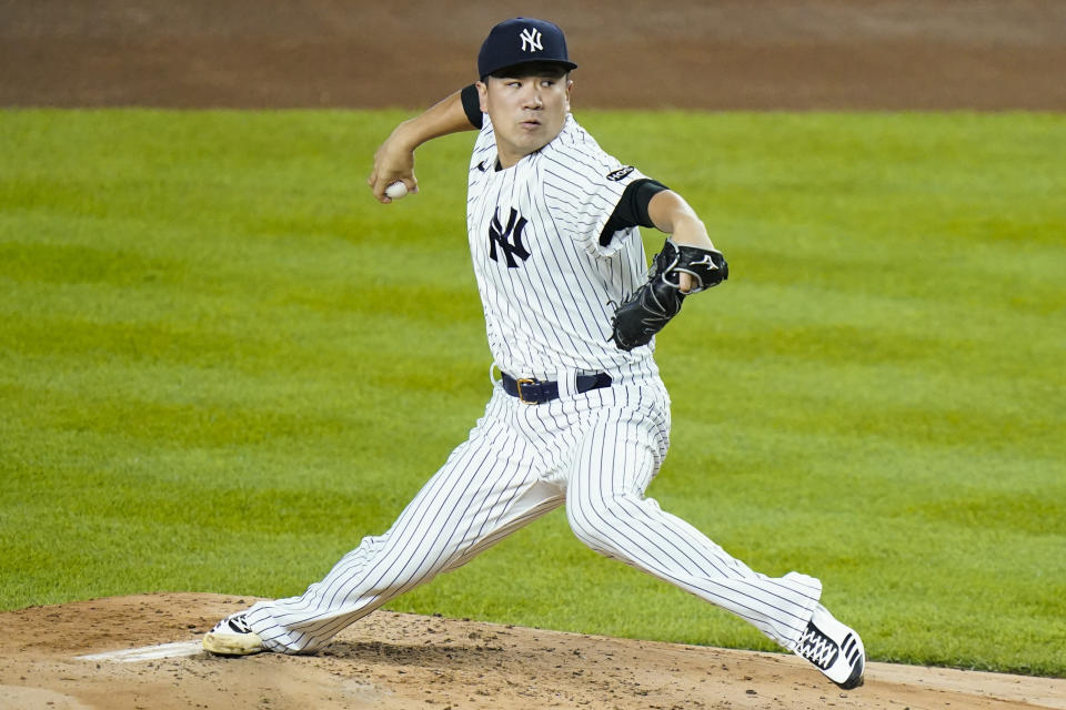 FILE - New York Yankees' Masahiro Tanaka, of Japan, delivers a pitch during the second inning of the team's baseball game against the Toronto Blue Jays in New York, in this Thursday, Sept. 17, 2020, file photo. Former New York Yankees pitcher Masahiro Tanaka has signed a two-year contract with the Rakuten Eagles in Japanese baseball, the club said Thursday, Jan. 28, 2021. (AP Photo/Frank Franklin II, File)