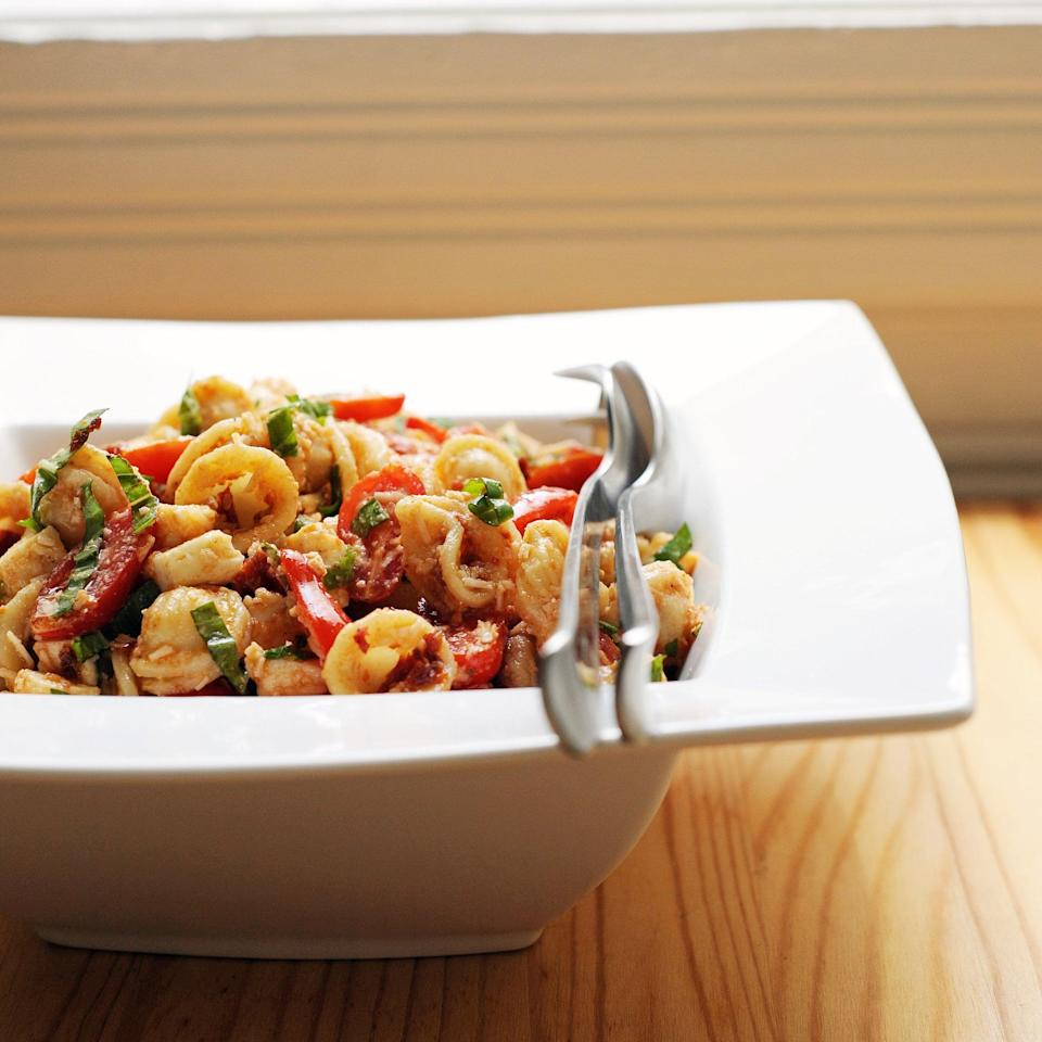 """<p><strong>Get the recipe:</strong> <a href=""""http://www.popsugar.com/food/Sun-Dried-Tomato-Pasta-Salad-4588604/"""" class=""""link rapid-noclick-resp"""" rel=""""nofollow noopener"""" target=""""_blank"""" data-ylk=""""slk:sun-dried tomato pasta salad"""">sun-dried tomato pasta salad</a><br> <strong>Cans needed:</strong> sun-dried tomatoes, capers, olives</p>"""