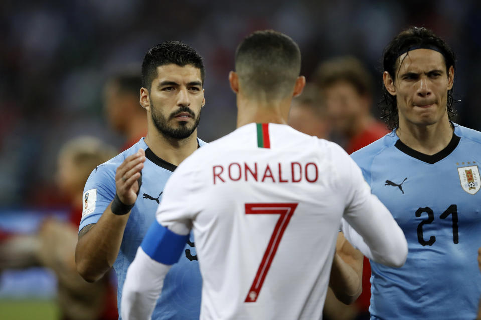 Luis Suarez of Uruguay shakes hands with Cristiano Ronaldo of Portugal during the 2018 FIFA World Cup Russia Round of 16 match between Uruguay and Portugal at Fisht Stadium on June 30, 2018, in Sochi, Russia. (Getty Images)