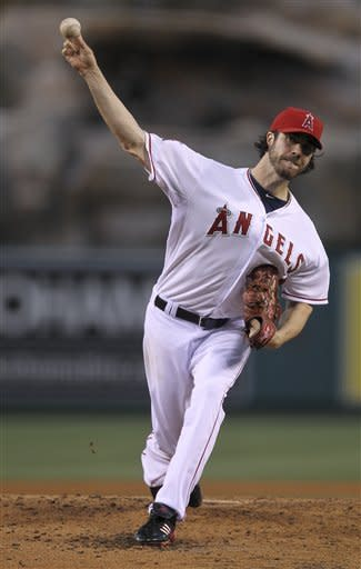Los Angeles Angels starting pitcher Dan Haren throws to the Oakland Athletics during the second inning of a baseball game in Anaheim, Calif., Monday, May 14, 2012. (AP Photo/Chris Carlson)