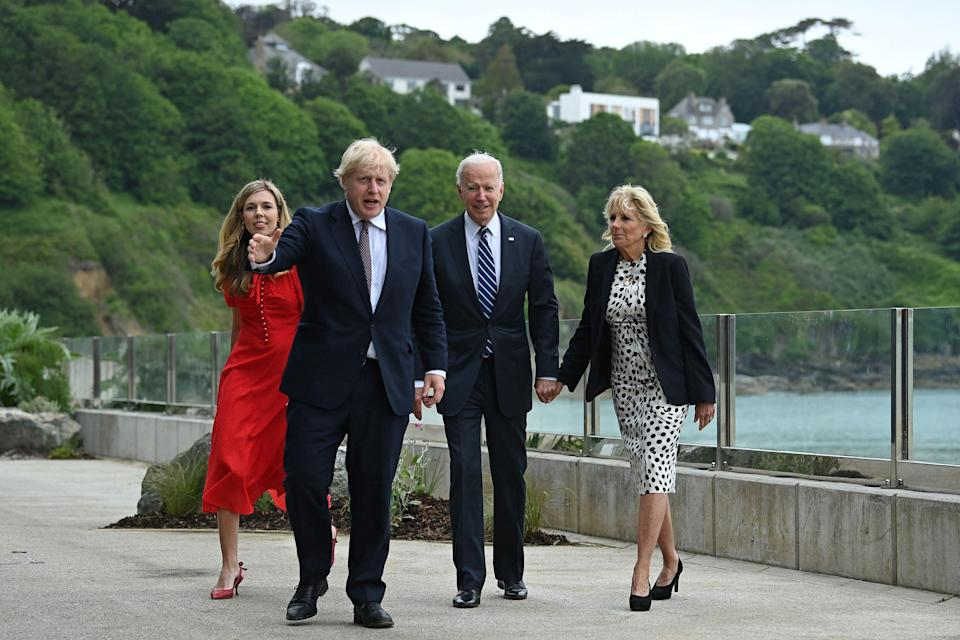 Boris Johnson, second left, and Carrie Johnson walk with Joe Biden, second right, and Jill Biden (AFP via Getty Images)