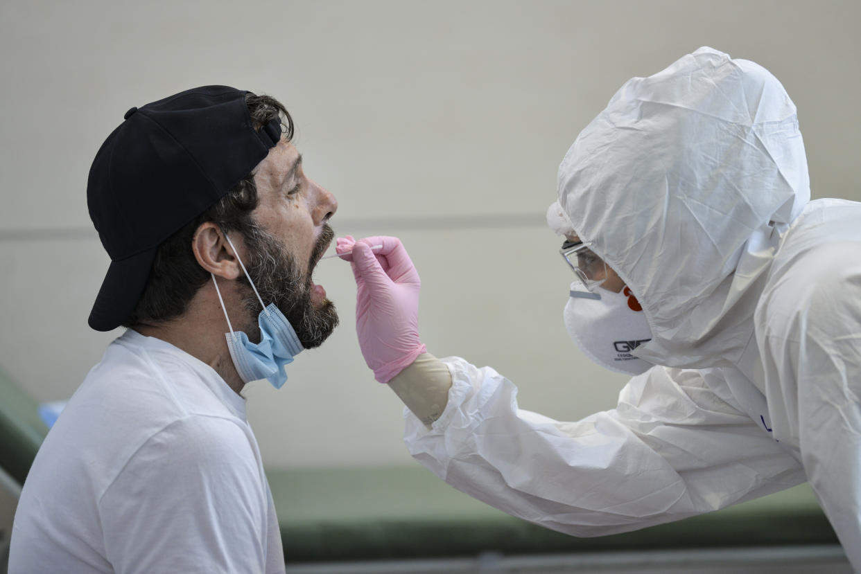 A man undergoes a swab test for Covid-19 at the testing site of Turin airport, Italy. (Getty)