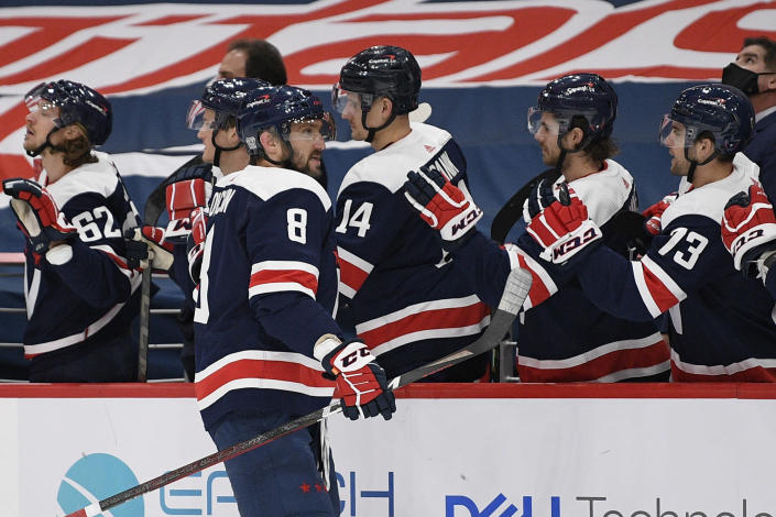 Washington Capitals left wing Alex Ovechkin (8), of Russia, celebrates his goal with the bench during the first period of an NHL hockey game against the Philadelphia Flyers, Sunday, Feb. 7, 2021, in Washington. (AP Photo/Nick Wass)