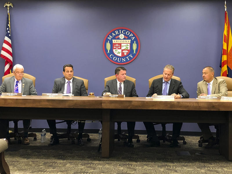 The Maricopa County Board of Supervisors takes the first step toward suspending an elected official accused of running a human smuggling scheme during a meeting in Phoenix Wednesday, Oct. 23, 2019. The Maricopa County Board of Supervisors voted unanimously Wednesday to notify Assessor Paul Petersen that it plans to consider suspending him for up to 120 days. It can't remove him from office and he's refused to resign. AP Photo/Jonathan J. Cooper)