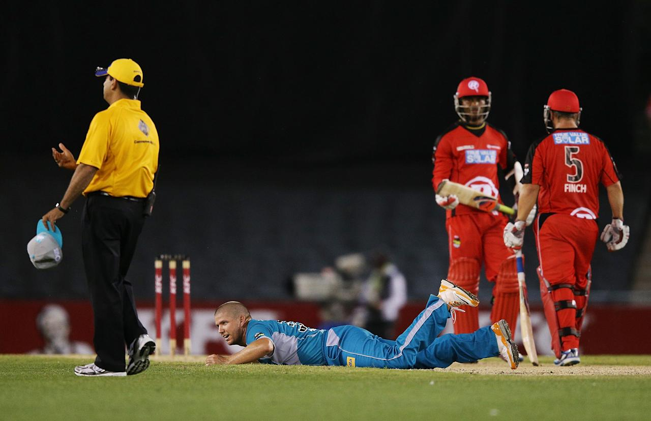 MELBOURNE, AUSTRALIA - DECEMBER 22: James Hopes of the Heat lays on the ground after being hit to the boundary by Marlon Samuels during the Big Bash League match between the Melborune Renegades and the Brisbane Heat at Etihad Stadium on December 22, 2012 in Melbourne, Australia.  (Photo by Michael Dodge/Getty Images)