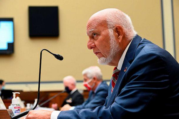 PHOTO: Robert Redfield, director of the CDC, testifies during a House Subcommittee on the Coronavirus Crisis hearing on a national plan to contain the COVID-19 pandemic on Capitol Hill in Washington, July 31, 2020. (Erin Scott/Pool/AFP via Getty Images)