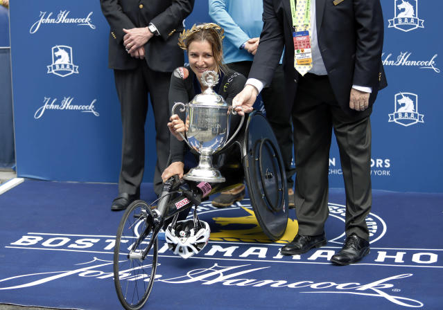 Manuela Schar, of Switzerland, receives the trophy after winning the women's handcycle division of the 123rd Boston Marathon on Monday, April 15, 2019, in Boston. (AP Photo/Winslow Townson)