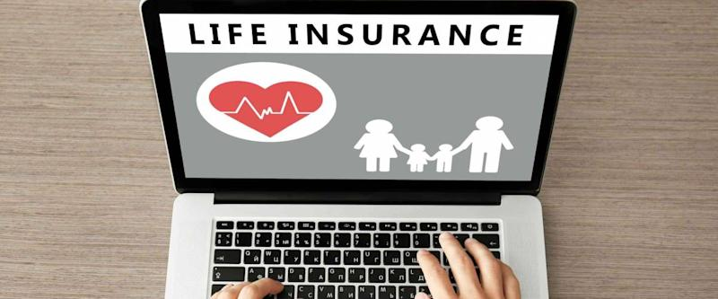 Man using laptop at wooden table. Life insurance concept