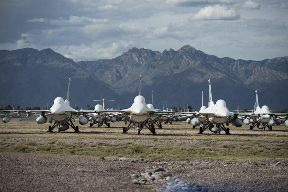 """<p>Established in 1946 to store World War II bombers and transports, the yard at the <a href=""""https://www.dm.af.mil/"""" rel=""""nofollow noopener"""" target=""""_blank"""" data-ylk=""""slk:Davis-Monthan Air Force Base"""" class=""""link rapid-noclick-resp"""">Davis-Monthan Air Force Base</a> outside Tucson holds more than 4,000 military aircrafts. Look out for personal notes etched on some planes by former pilots. The base also <a href=""""https://www.youtube.com/watch?v=_wuVofb0L-Q"""" rel=""""nofollow noopener"""" target=""""_blank"""" data-ylk=""""slk:made an appearance"""" class=""""link rapid-noclick-resp"""">made an appearance</a> in the 1987 movie <em>Can't Buy Me Love,</em> starring a young Patrick Dempsey. </p>"""