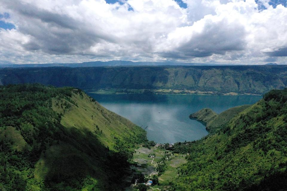 <p>Indonesia's Lake Toba was formed by a gigantic volcanic eruption some 70,000 years ago</p> (GOH CHAI HIN/AFP via Getty Images)
