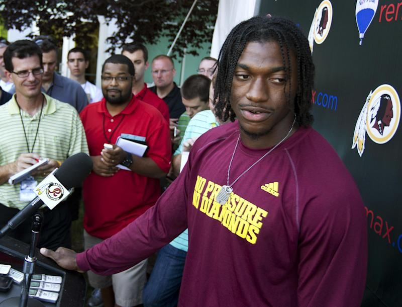 Washington Redskins quarterback Robert Griffin III speaks to reporters during an NFL football news conference in Ashburn, Va., Wednesday, July 25, 2012.   (AP Photo/Manuel Balce Ceneta)