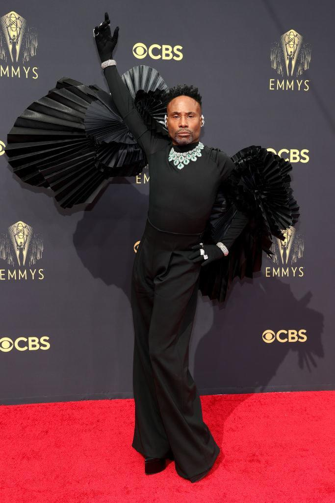 Billy Porter on the red carpet in a black wide-leg jumpsuit with frills on top